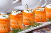 Appetizer Of Fresh Carrot Rolls With Cream Cheese