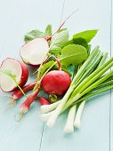 stock photo of leek  - Leek radish on the wooden background - JPG