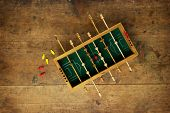 Mini soccer game on an old wooden table. Tactics, game planning concept.