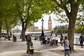 LONDON, UK - MAY 14, 2014: People on south bank of the river Thames