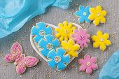 Flowers cookies on a wooden background