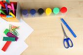 Composition of various creative tools  on color wooden background