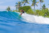 Surfing A Wave. Bali Island. Indonesia.
