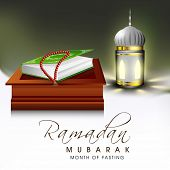 stock photo of islamic religious holy book  - Religious holy book of Islamic religion Quran Shareef and praying mantis with arabic lantern for celebration of holy month Ramadan Mubarak - JPG