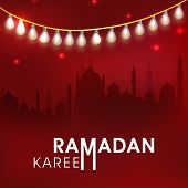 Beautiful greeting card design with silhouette of mosque in shiny night background for Ramadan Karee