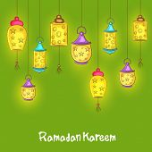 Illuminated hanging lanterns on green background for holy month of Muslim community Ramadan Kareem o