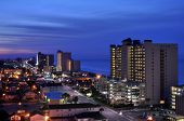 picture of beachfront  - Coastal strip illuminated by city lights and beachfront hotels - JPG