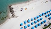 Top View Of Beach With Tourists, Sunbeds And Umbrellas. Sea Travel Destination. Holiday's Background poster