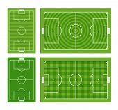 Different green football fields set