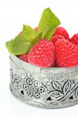 Fresh Raspberries In Small Delicate Metal Casket Over White