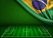 Soccer field or pitch with flag of Brazil concept