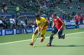 THE HAGUE, NETHERLANDS - JUNE 2: Englishman Catlin reaches for the ball to stop a rush by Indian pla