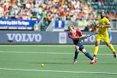 THE HAGUE, NETHERLANDS - JUNE 2: English Player Barry Middleton passes the ball forward during the m