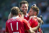THE HAGUE, NETHERLANDS - JUNE 2: English field hockey players celebrate after Simon Mantell scores t