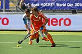 THE HAGUE, NETHERLANDS - JUNE 1: Field hockey player Jonker (NED) leads the ball in front of Rey (AR