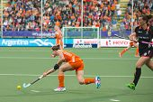 THE HAGUE, NETHERLANDS - JUNE 2: Dutch Jonker is passing the ball Belgium player De Groof is right behind her during the Hockey World Cup 2014 (women) NED beats BEL 4-0