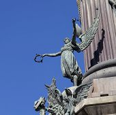 Winged figure on the Columbus monument in Barcelona. Columbus monument is tall monument for Christop