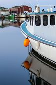 foto of lobster boat  - Evening light on lobster boats tied up at the wharf in rural Prince Edward Island - JPG