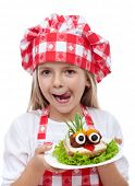 Happy little girl with chef hat and creative sandwich- isolated portrait