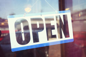 image of windows doors  - Open for business sign shot through a dirty diner window - JPG
