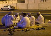 Arabic Men Play Cards at night