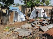 Disaster Relief Tents Erected Next To Badly Damaged Houses