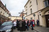KRAKOW, POLAND - APR 18, 2014: Unidentified participants of the Way of the Cross on Good Friday celebrated at the historic center of Krakow.