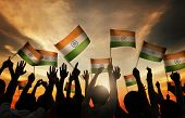 picture of indian flag  - Group of People Waving Indian Flags in Back Lit - JPG