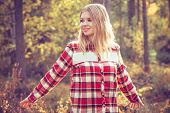 Young Woman walking outdoor wearing hipster plaid shirt Lifestyle Travel