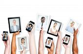 Headshots of Multi-Ethnic Group of People and Social Media Concepts