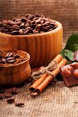 coffee beans in a wooden bowl on burlap background