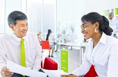 Multi-Ethnical Business Man And Woman Working Together