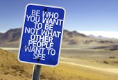 stock photo of envy  - Be Who You Want To Be Not What Other People Want To See sign with a desert background - JPG