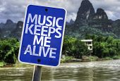 Music Keeps Me Alive sign with a forest background