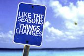 Like the Seasons Things Changes sign with a beach on background