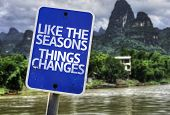 Like the Seasons Things Changes sign with a forest background