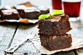 stock photo of brownie  - brownie on a dark wood background for dessert - JPG