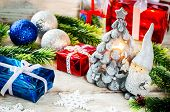 Christmas Background With Gifts, Santa Claus And Balls