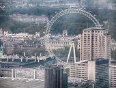 LONDON - 09 JUNE 2013: Aerial view of London Eye ferris wheel in England on 09 June 2013