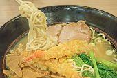 A Bowl Of Japanese Noodle Soup With Shrimp Tempura