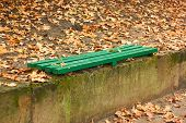 Green Wooden Bench Among Autumn Leaves