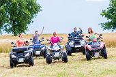 Friends driving off-road with quad bike or ATV