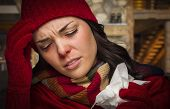 Bundled Up Sick Woman Inside Cabin With Tissue.