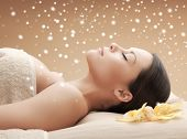 beauty, health, people and spa concept - beautiful young woman in spa