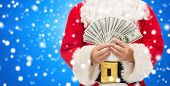 christmas, holidays, winning, currency and people concept - close up of santa claus with dollar money over blue snowy background