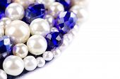 White pearl and blue strass.