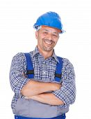Happy manual worker with arms crossed