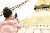 Traveller Woman Capturing Photo Of Boudhanath
