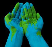 World map painted on human hands
