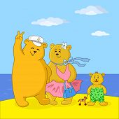 Teddy bears family on a beach